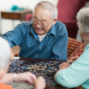 Man working on puzzle